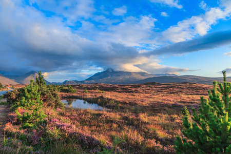 Footage of a moorland on the Isle of Skye in Scotland at sunset with impressive cloud formations