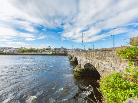 Thomond bridge in Limerick with river Shannon during daytime
