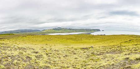 View on black Reynisfjara beach with impressive basalt columns in Southern Iceland in summer