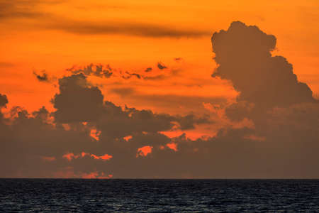 Picture of the sunset at Kamala Beach on the Thai holiday island of Phuket with cloud formations around backlight photographed in November 2013 Archivio Fotografico