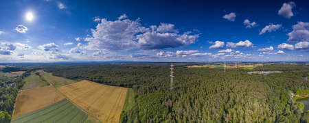 Aerial panoramic picture of a high voltage power line in forest area in Germany Archivio Fotografico