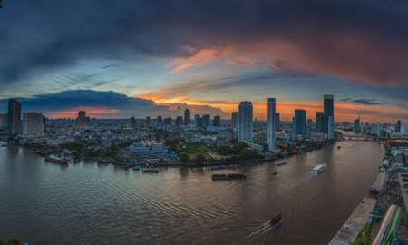 Panoramic view of Bangkok with Chao Phraya river photographed from a bird's eye view in the evening at the blue hour with light cloud cover in September 2016 Archivio Fotografico