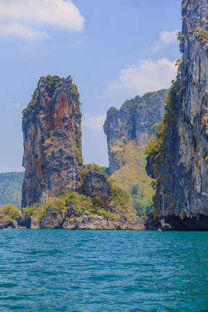 Photograph during a trip between the islands of Krabi with imposing rocks in the sea during the day in Thailand in November 2013