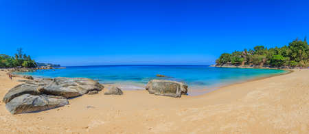 Panoramic view of Leam Sing Beach on Phuket with rocks in the foreground photographed during the day in cloudless skies in November 2015 Archivio Fotografico