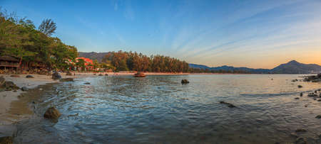 Panoramic image of Kamala Beach on Phuket photographed in the evening light in Thailand in November 2015