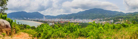 Panoramic view of The Bay of Patong with Patong Beach photographed during the day in cloudy skies in Thailand in November 2013