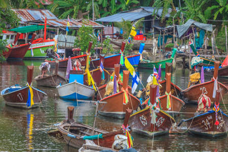 Typical Thai fishing boats in small harbor on Phuket