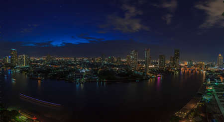 Panoramic aerial night picture of the Bangkok skyline and Chao Phraya river