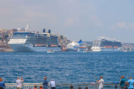 Photo of cruise ships in the port of Istanbul photographed from the Galata Bridge during the day in Turkey in April 2014