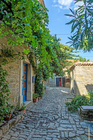 Typical street scene of the medieval town of Groznjan on the Istrian peninsula without people during daytime