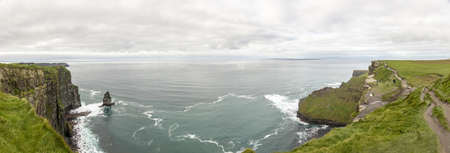 Panorama picture of the Cliffs of Moher at the west coast of Ireland during daytime