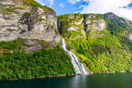 View on Friarfossen waterfall in Geiranger fjord from cruise ship Stok Fotoğraf