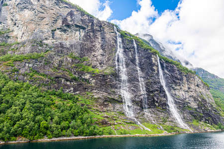 View to Seven Sisters waterfalls in Geiranger fjord from cruise ship