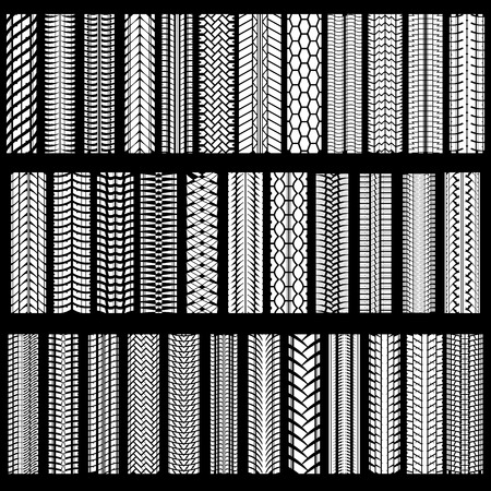treads: Set of white tire tracks silhouette on black background