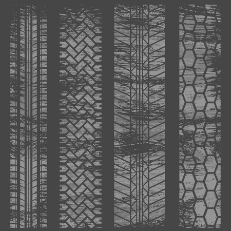 Four tire track white grunge silhouettes isolated on dark background