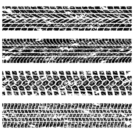 Set of four grunge tire track silhouettes isolated on white background