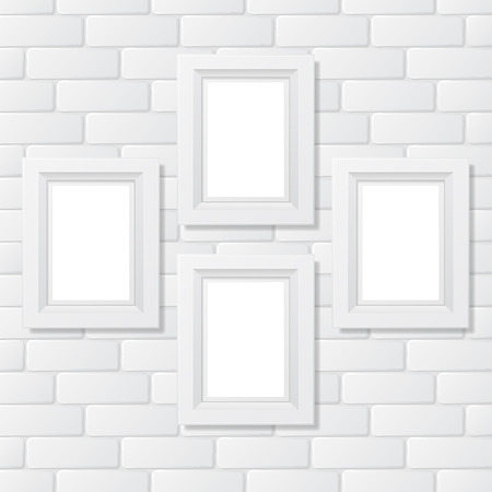Four picture frames on brick wall