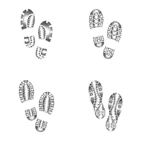 Set of four pairs of black dotted outline shoes prints