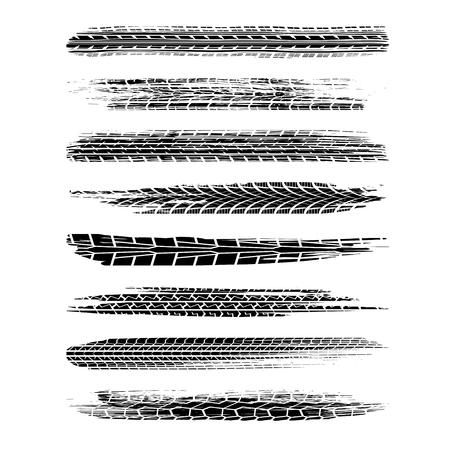 Set of eight black grunge tire tracks isolated on white background