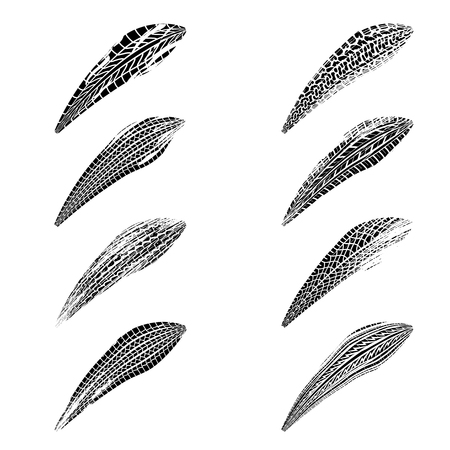 Set of eight black brush tire tracks isolated on white background