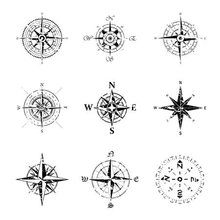 Ensemble de neuf silhouettes de rose des vents grunge noir isolé sur fond blanc Vecteurs