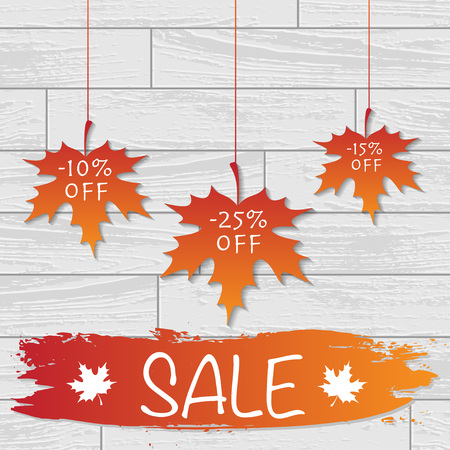 White laminate wooden texture background with autumn color leaves and sale discount text