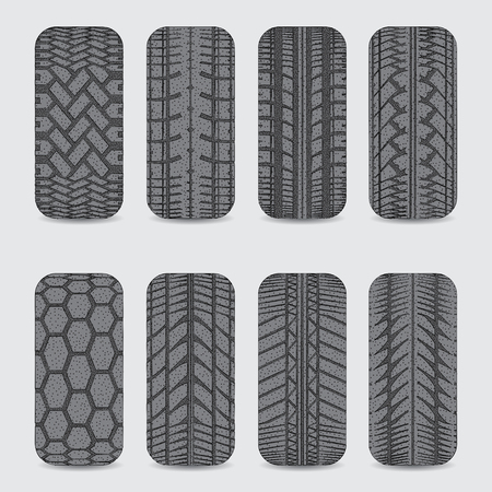 Set of eight black car tire tracks with dots