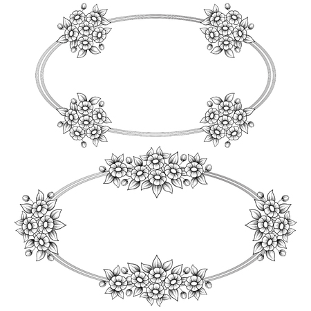 Two black and white oval frames with floral elements