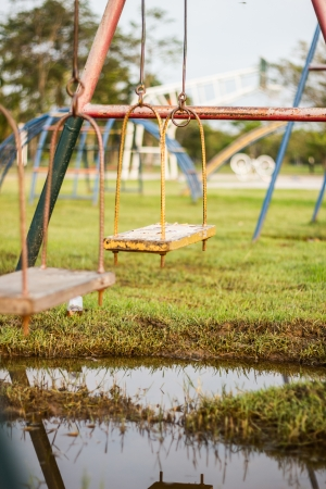 swing in playground after rainny photo