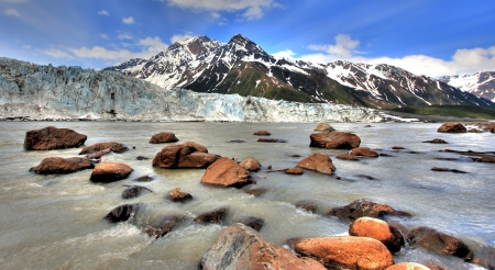 calving: River Flowing Against Alaskan Glacier Stock Photo