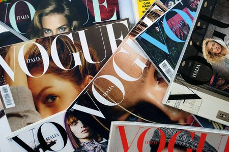 Heap of Vogue Italia fashion, beauty and lifestyle magazines. Pile of Conde Nast publications cover headlines