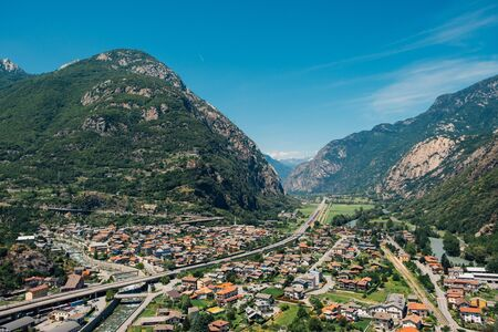 Beautiful landscape in the Aosta Valley mountainous region in northwestern Italy. Alpine valley in summer seen from fort Bard. Hone, Bard, Valle d Aosta. Dora Baltea river