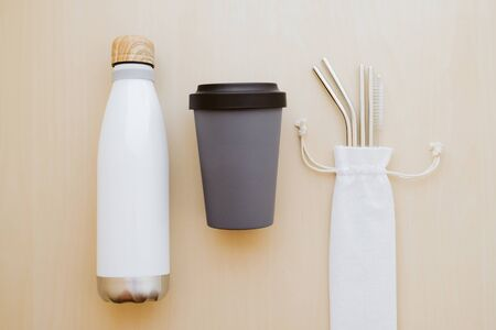 Reusable plastic free and eco friendly utensils. Metal drinking straws, bamboo cup and water bottle. Reklamní fotografie