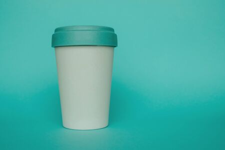 Reusable plastic free eco friendly bamboo cup for take away coffee on light blue background. Copy space. Bring your own cup concept. Zero waste, sustainable lifestyle. 版權商用圖片