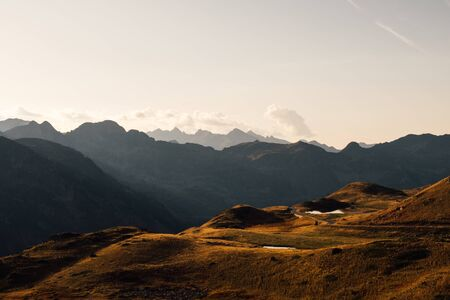 Beautiful landscape with mountain silhouettes in the Alps during sunset.