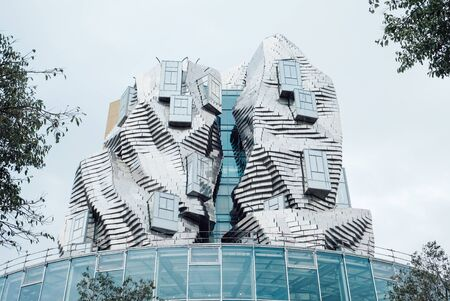 Arles, France, September 22, 2019. Twisting tower in reflective aluminium panels designed by architect Frank Gehry for Luma Arles cultural centre. Contemporary architecture. Editorial