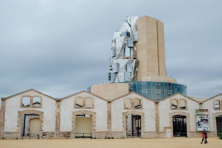 Twisting tower in reflective aluminium panels designed by architect Frank Gehry for Luma Arles cultural centre. Editorial