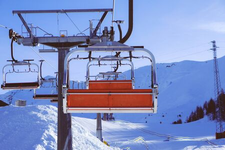 Chairlift or elevated passenger ropeway at ski area. Winter ski resort.