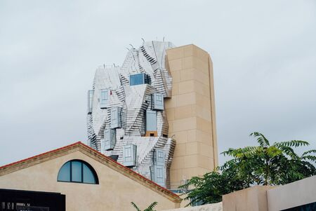 Twisting tower in reflective aluminium panels designed by architect Frank Gehry for Luma Arles cultural centre. Arles, France - September 21, 2019. Editorial