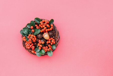 Beautiful eco friendly Christmas wreath on red background. Creative plastic free natural festive garland, top view, flat lay style. Space for text. Zero waste holiday concept. Banco de Imagens