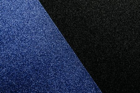 Bicolor geometric blue and black glittery background with space for text.