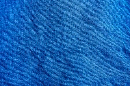 Blue crumpled jeans texture