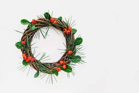 Pretty eco friendly Christmas wreath made of natural materials on white wooden