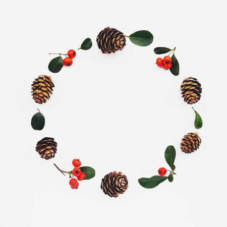 Beautiful eco friendly Christmas wreath made of pine cones  branches on white wooden Banco de Imagens