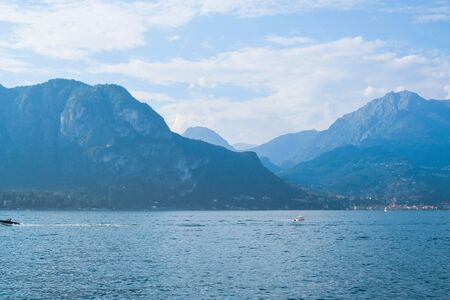 Mountain landscape with Como Lake or Lago di Como, popular tourist attraction in Lombardy, Northern Italy. Copy space. Summer vacations concept. Banco de Imagens