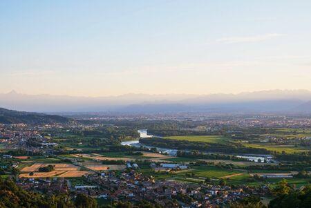 Beautiful landscape in Piedmont, hilly region in northwestern Italy. Po river, Italian Alps.