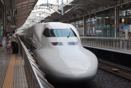 KYOTO, JAPAN - AUGUST 14  Shinkansen train waits for departure ar rail terminal in Japan on August 14, 2012  Shinkansen is a network of high-speed railway lines in Japan connecting whole country