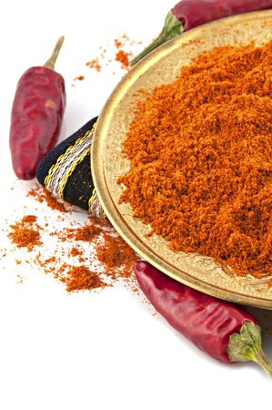 plate of chili red pepper powder and whole dried chili peppers