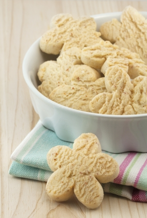 Handful of traditional holiday homemade vanilla rock cookies on the wooden tray photo