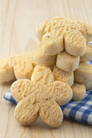 Handful of traditional holiday homemade vanilla rock cookies on the wooden tray Stock Photo - 21527683